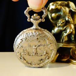 Японски джобен часовник с ловни сцени.